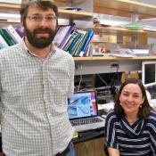 Matthew Shawkey and Liliana D'Alba in their lab at the University of Akron.  The team studies the micro-structures of feathers.