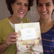 Maria Isabella and her daughter Andrea with their family cookbook. It was a labor of love Isabella made for her five children as a Christmas present a few years ago, with 100 of their favorite recipes.