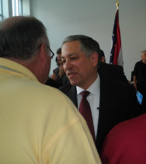 Budish greets a supporter after announcing he's running for Cuyahoga County executive.