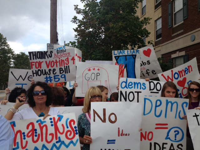 Protesters gather outside the Democratic Party Headquarters to support the budget.