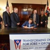 Gov. Kasich says Ohio has see a miraculous turnaround thanks to budgets like the one he signed last month.