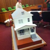 A model of Ariel Castro's home makes its way into the center of the courtroom for Thursday's hearing.