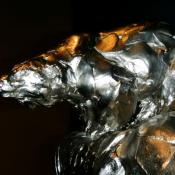 "Bart Walter's bronze ""Climate Change"" shows a polar bear's tenuous grip on a melting ice flow."