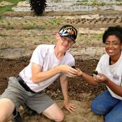 Brian Cokin does some transplanting with his job coach, Jamelia Maxwell.