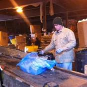Brian Krigmont sorts cans and plastic bottles out of recycling waste bags at Recycle Midwest in Cleveland.