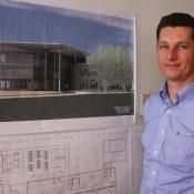 Australian born Sean Wescott leads the research team at Nestle's Solon research center. The new product technology center pictured on his office wall will bring all of the company's frozen and chilled food research to northeast Ohio.