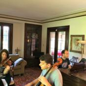 Co-founders of ChamberFest Cleveland, Franklin and Diana Cohen transform the family home into a rehearsal space during the festival. Violinist Amy Schwartz Moretti, cellist Gabriel Cabezas and pianist Orion Weiss are shown here rehearsing Haydn's Trio for Piano and Strings No. 39 in G major, Gypsy Rondo, in the Cohen's living room.