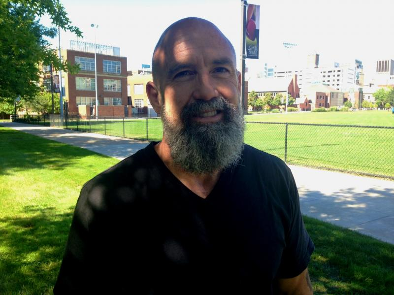 Tim Gerken, 52, of New York has wrestled most of his life and coached during college.