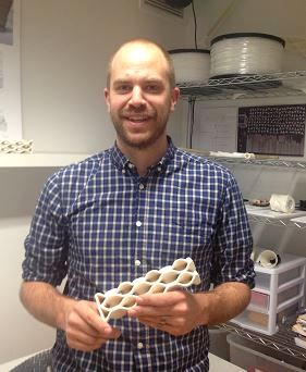 Professor Brian Peters shows off one of his honeycomb shaped bricks.