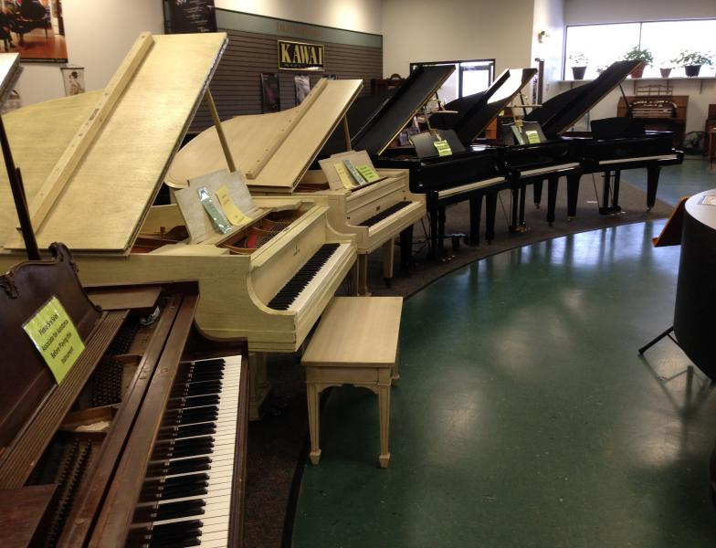 New and used pianos in front row