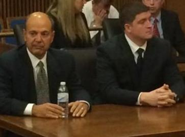 Michael Brelo and defense attorney Pat D'Angelo await the verdict