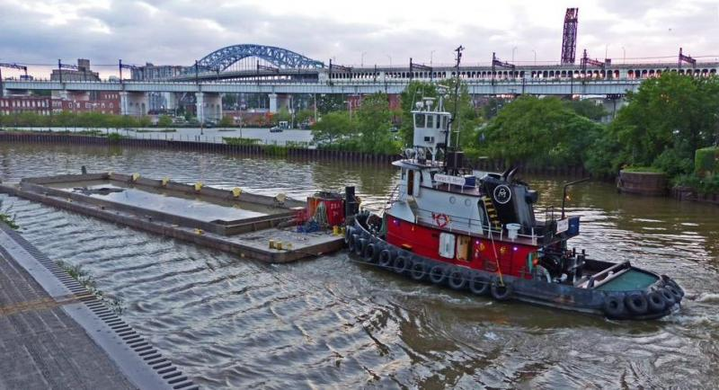a tugboat run by Ryba Marine pushing dredged sediment upriver